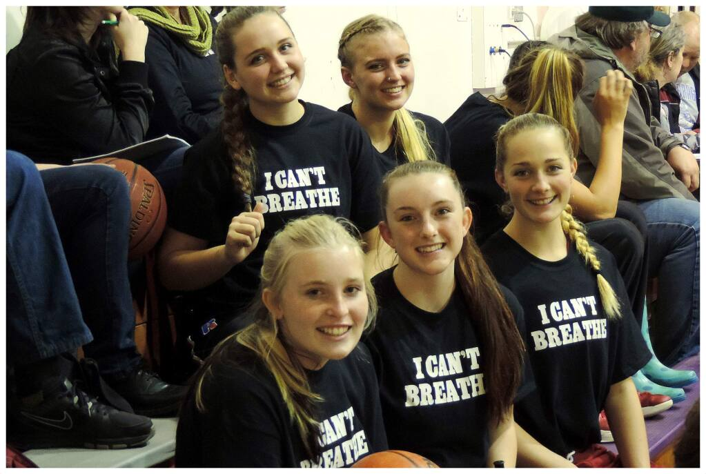 Members of the Mendocino High School varsity girls basketball team sit courtside before their Dec. 16 game at Fort Bragg High School. In front, from left, are Aimee Gordon, Naomi Baker and Sunny Scott. Behind them are Isobell Hall, left, and Michaela Hubbard. (Photo by Mendocinosportsplus)