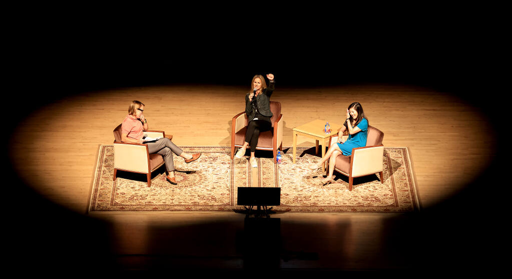 Brandi Chastain, middle, and Kristi Yamaguchi, right, answer audience questions from Press Democrat journalist Kerry Benefield, Wednesday, Sept. 22, 2021 during the Women in Conversation at the Green Music Center at Sonoma State University.  (Kent Porter / The Press Democrat) 2021