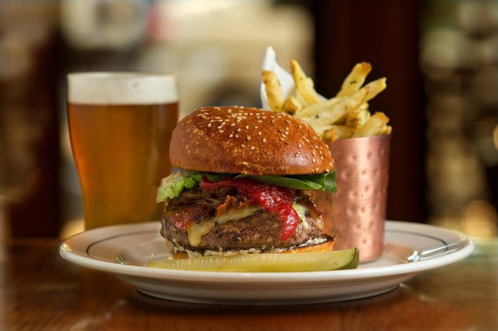 Beefa Spring Burger with slow-cooked onion, bacon, cheddar, summer truffle aioli and Kennebec fries from the Brass Rabbit in Healdsburg. (JOHN BURGESS/ PD)