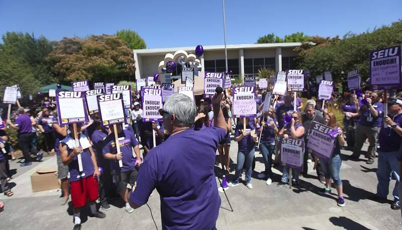 SEIU 1021 union members with the County of Sonoma rally in front of the Sonoma County Board of Supervisors, Tuesday July 31, 2012 in Santa Rosa. (Kent Porter / Press Democrat) 2012
