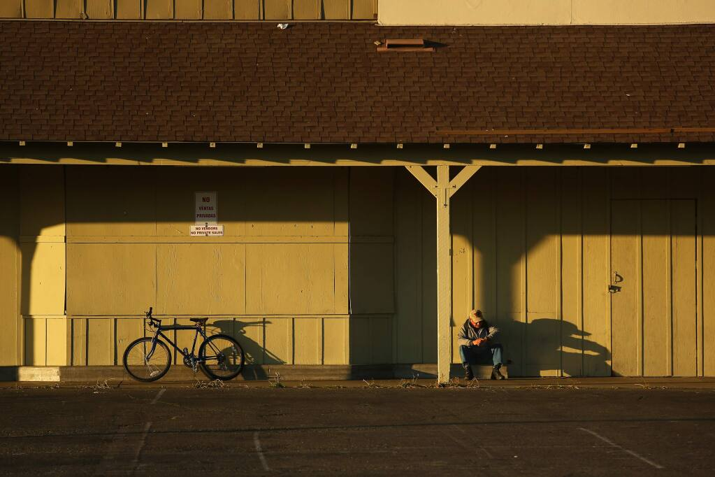 A girl rides her bicycle near the site of old Albertson's on Sebastopol Ave. on Sunday, June 14, 2015 south of Santa Rosa, California . (BETH SCHLANKER/ The Press Democrat)