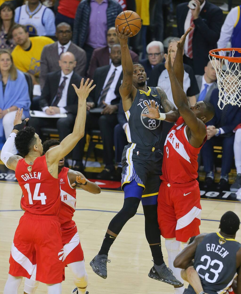 Golden State Warriors forward Alfonzo McKinnie shoots over Toronto Raptors center Serge Ibaka during Game 4 of the NBA Finals in Oakland on Friday, June 7, 2019. (Christopher Chung / The Press Democrat)