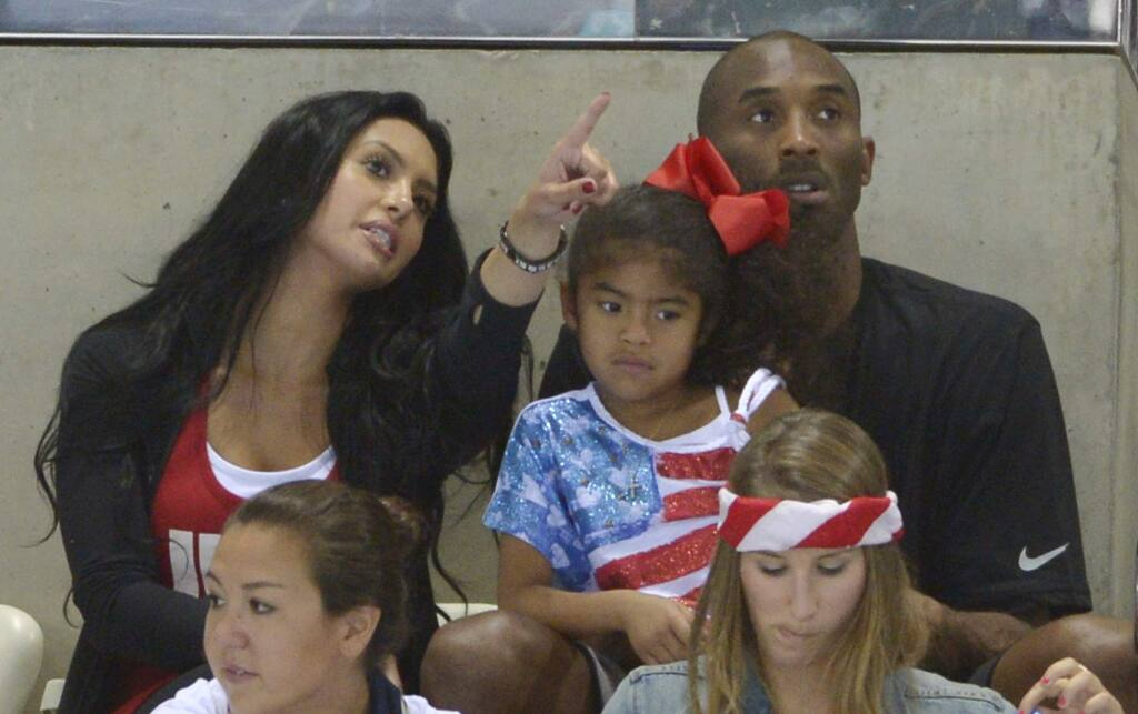 FILE - In this Aug. 4, 2012 file photo Kobe Bryant with his wife Vanessa and daughter Gianna prepare to watch the final night of swimming at the Aquatics Centre in the Olympic Park during the 2012 Summer Olympics in London. Vanessa Bryant expressed grief and anger in an Instagram post Monday, Feb. 10, 2020, as she copes with the deaths of her husband Kobe Bryant, their daughter Gigi and seven other people in a helicopter crash last month. (AP Photo/Mark J. Terrill,File)