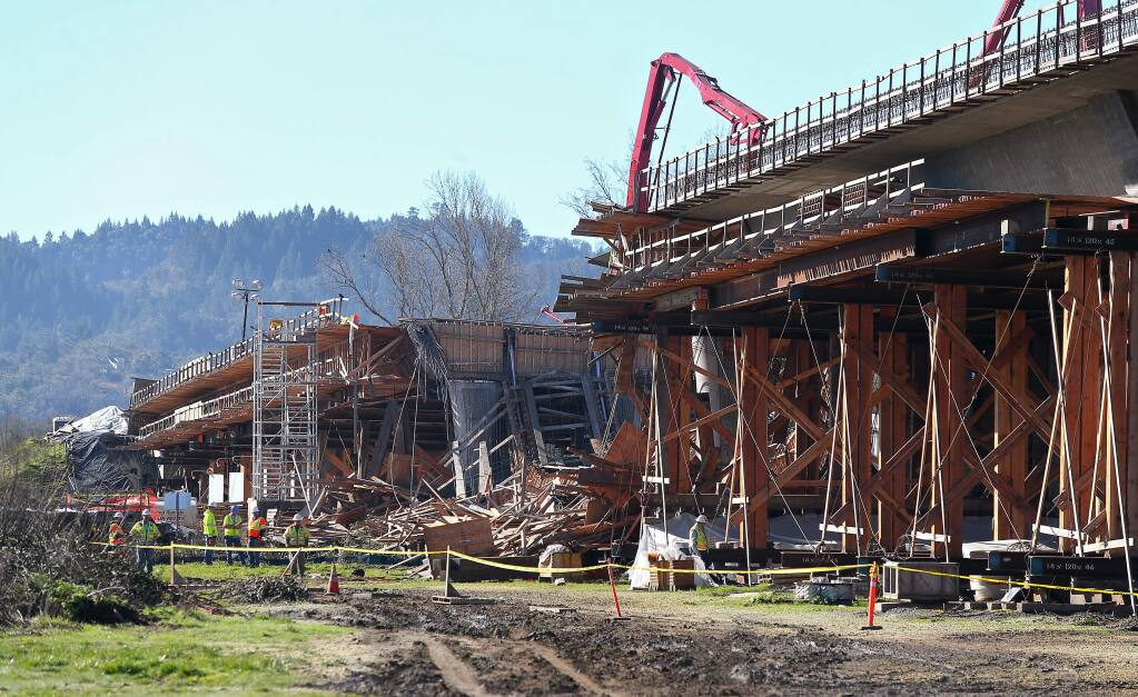 CalTrans and construction personnel view the bypass bridge collapse in Willits on Friday, January 23, 2015. (Christopher Chung/ The Press Democrat)