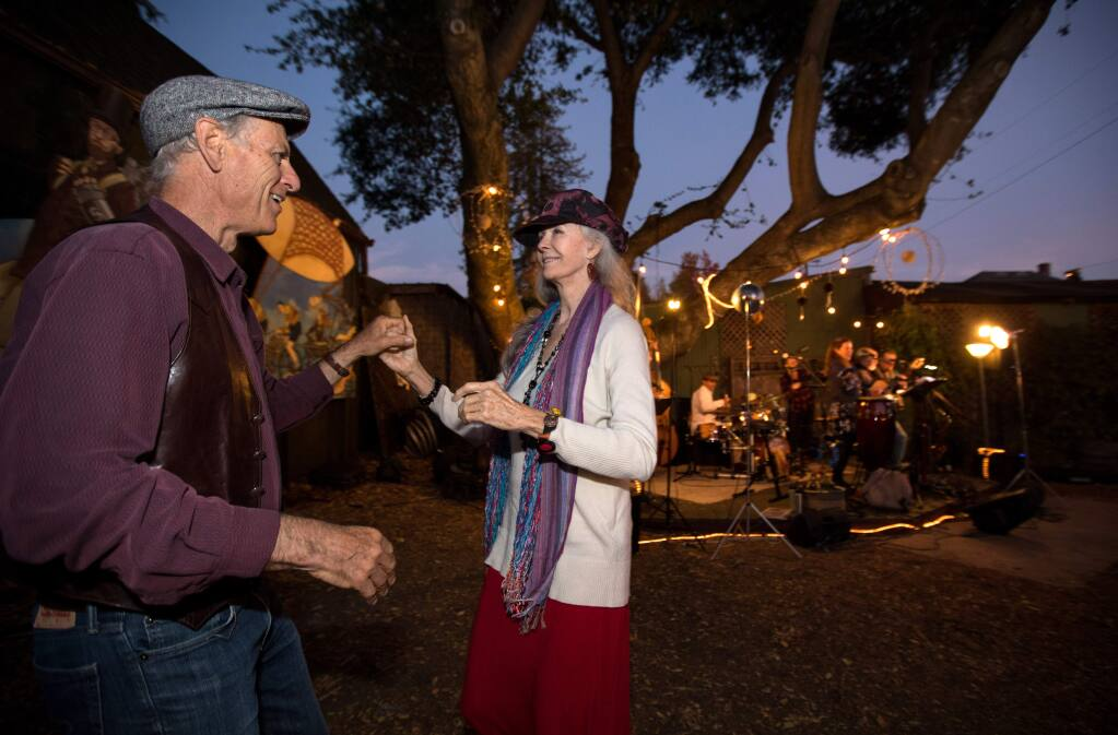 Katherine Yates of Petaluma and Peter Schurch of Sebastopol, dance to the music of 'Joy Ride' at the Winterblast street party and arts fest, in Santa Rosa, Calif., on Saturday, November 9, 2019. (Photo by Darryl Bush / For The Press Democrat)