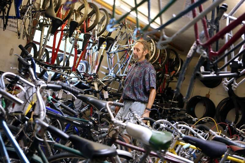 Michael Teller looks through his inventory of donated bicycles and bicycle parts at Community Bikes off of Sebastopol Road in Santa Rosa on Thursday, July 25, 2013. (Conner Jay / The Press Democrat)