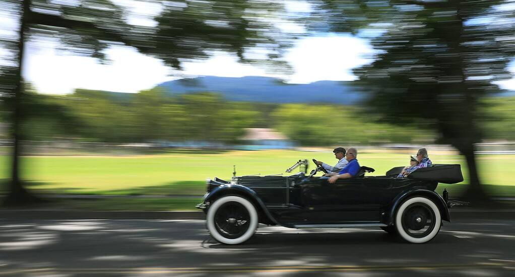 After rallying with other Pierce Arrow drivers at Jack London State Park in Glen Ellen, Thursday, July 12, 2018, a Pierce Arrow is driven along Arnold Drive. The cars were widely accepted as luxury vehicles in the early twentieth century and will be on display to the public tomorrow in Rohnert Park. (Kent Porter / The Press Democrat) 2018