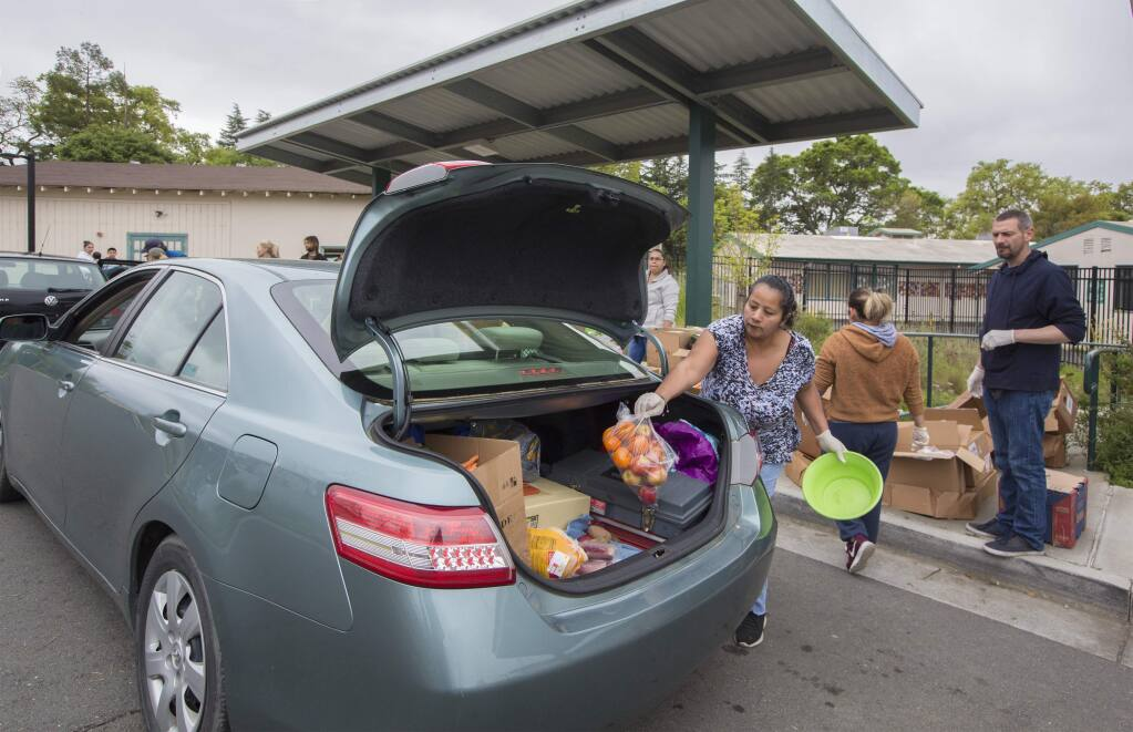 Denia Olea was one of many volunteers who distributed food from the Redwood Empire Food bank at the Flowery Elementary School in Boys Hot Springs on Monday, March 30. (Photo by Robbi Pengelly/Index-Tribune)