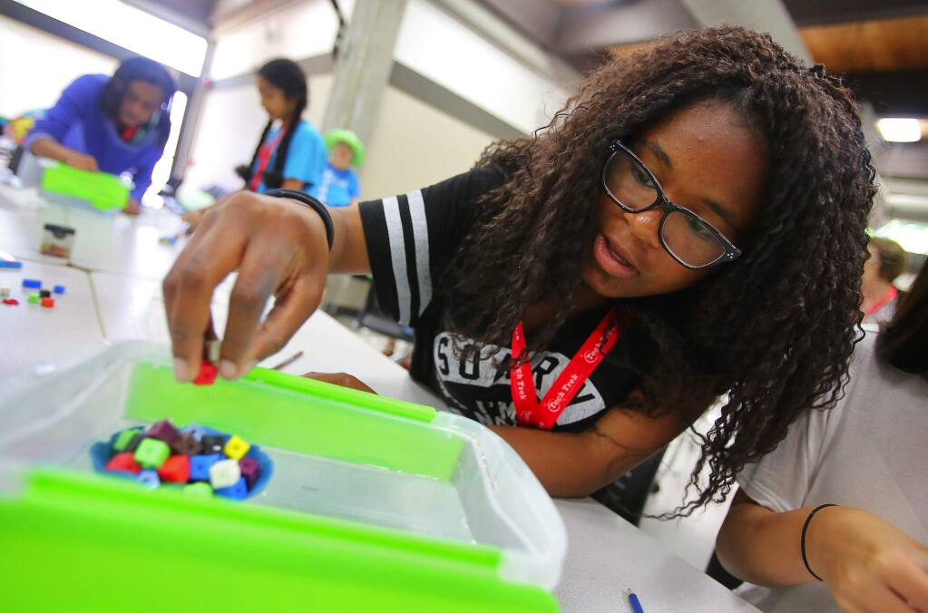 Amaya Watson carefully places blocks into a clay boat that she made during the Tech Trek camp, on the Sonoma State University campus in Rohnert Park on Thursday, June 22, 2017. The Tech Trek camp, by the American Association of University Women, provides a week-long hands-on experience for girls in science, technology engineering, and math.(Christopher Chung/ The Press Democrat)