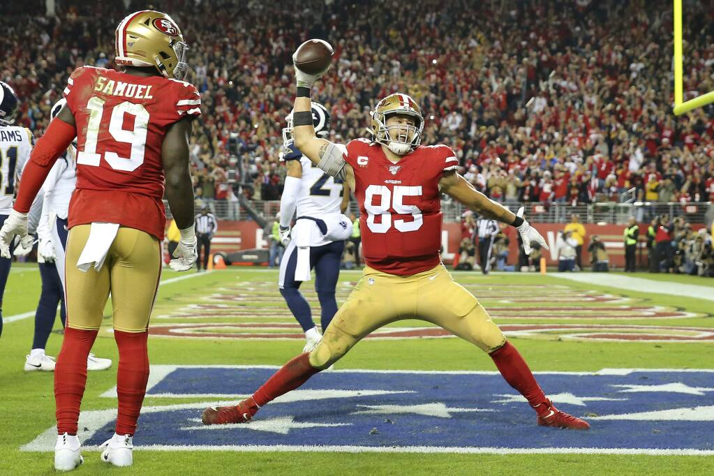 San Francisco 49ers tight end George Kittle celebrates after scoring against the Los Angeles Rams during the second half in Santa Clara, Saturday, Dec. 21, 2019. (AP Photo/John Hefti)