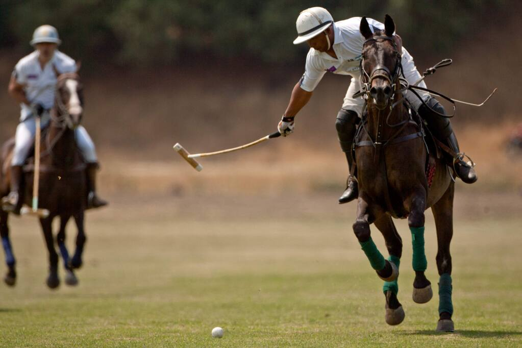 Alberto Gonzales of Team Argentina makes a shot on goal during a match against Team USA in the International Polo Classic at the Cerro Pampa Polo Fields in Petaluma, California, on August 3, 2014. (Alvin Jornada / For The Press Democrat)
