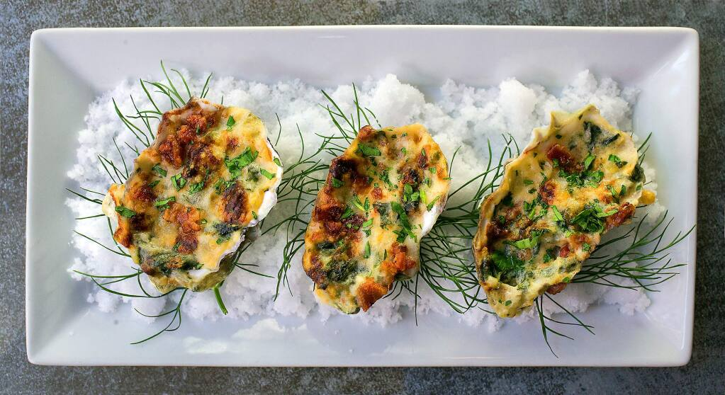 Baked Oysters Bucher with kale, artichoke, leeks, cream, bacon and truffle butter from Lovina in Calistoga. (photo by John Burgess/The Press Democrat)