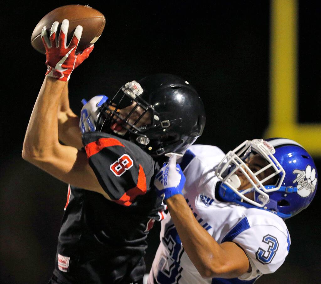 El Molino's Jackson Dunkle, left, pulls in a pass to give El Molino 1st and goal with only a few seconds remaining in the first half between Analy and El Molino high schools in Forestville on Friday, Sept. 14, 2018. (Alvin Jornada / The Press Democrat)