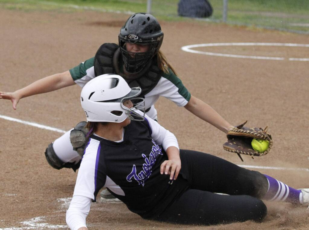 Bill Hoban/Index-TribuneSonoma catcher Lyndsey Lee tags a Petaluma runner out at home in thursday's game. Sonoma took an early lead, but the Trojand came back and won 13-3.