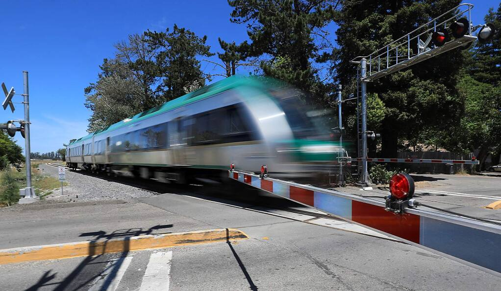 A southbound SMART train rolls through the Scenic Avenue crossing, north of Rohnert Park, where a man who was lying on the tracks was struck and killed Tuesday, July 9, 2019. Photo taken Wednesday, July 10, 2019. (KENT PORTER/ PD)