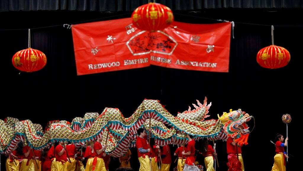Dragon dancers coil around the stage during the Chinese New Year celebration presented by the Redwood Empire Chinese Association at Veterans Memorial Hall in Santa Rosa. (Alvin Jornado/Press Democrat.)