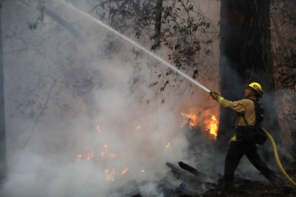 Ruben Mercado, a firefighter from Burbank, helped battle widlfires in Santa Rosa last fall under the state's mutual aid system. (MARCIO JOSE SANCHEZ / Associated Press)