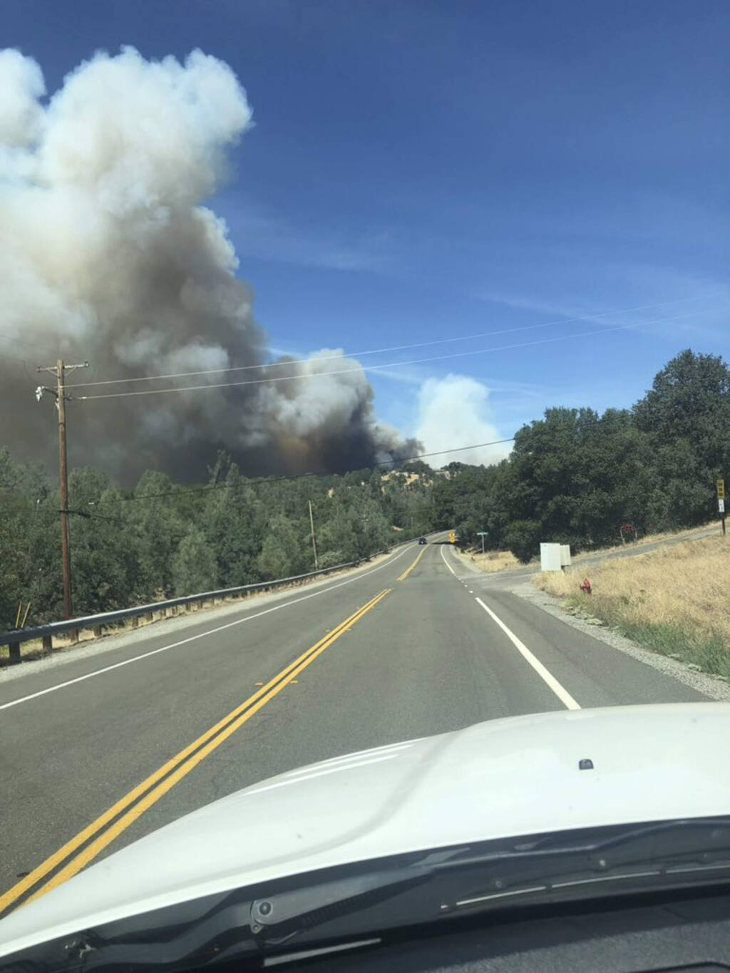 This photo provided by Cal Fire shows the Mountain fire burning Thursday, Aug. 22, 2019, near Redding, Calif. (Cal Fire via AP)