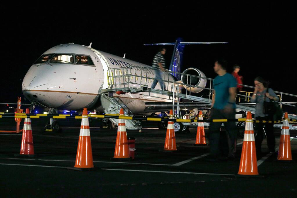 Passengers disembark from United Airlines Flight 5709 from San Francisco at Charles M. Schulz–Sonoma County Airport, in Santa Rosa, California, on Wednesday, October 10, 2018. (Alvin Jornada / The Press Democrat)