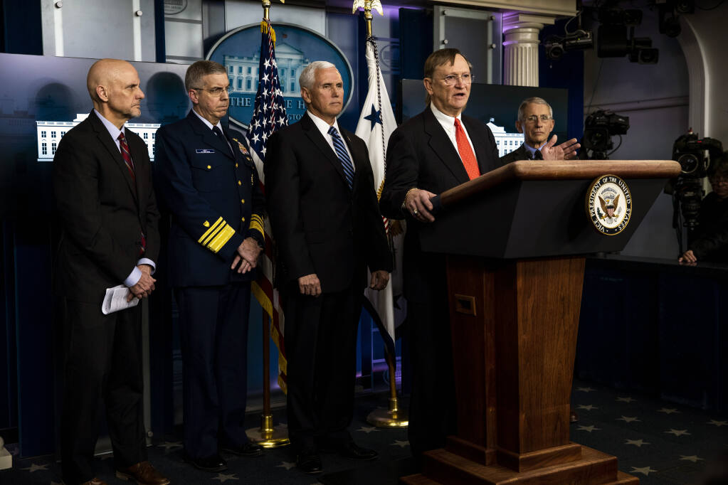 Dr. Robert Kadlec, who was with the Department of Health and Human Services under the Trump administration, is accompanied by members of the coronavirus task force as he speaks to reporters in Washington on March 6, 2020. The Emergent BioSolutions plant in Baltimore that recently had to scrap up to 15 million ruined doses of COVID-19 vaccine had flouted rules and downplayed errors, according to internal audits, ex-employees and clients. (Anna Moneymaker/The New York Times)