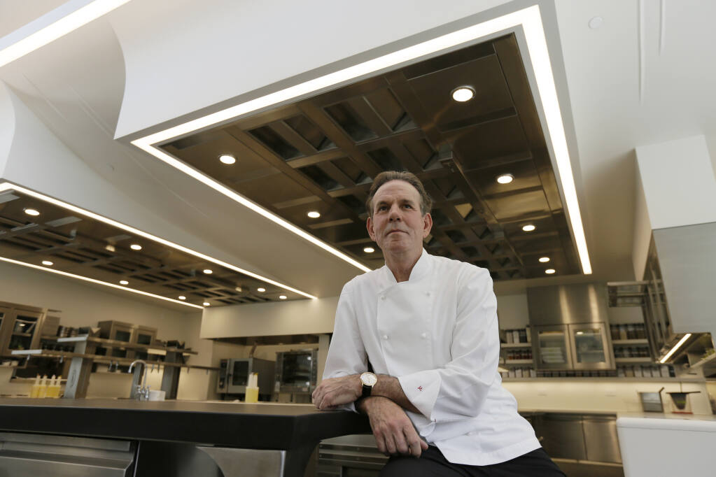 Chef Thomas Keller, seen in this 2017 photo in his French Laundry restaurant in Yountville, has filed one of an estimated 1,300 lawsuits nationwide challenging insurer denials of business-interruption claims related to government orders to close restaurant dining to varying degrees to slow the coronavirus pandemic. (AP Photo/Eric Risberg)