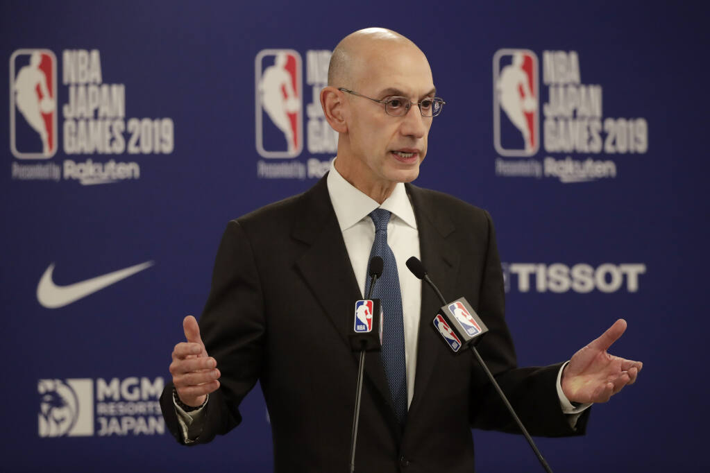 In this Oct. 8, 2019, file photo, NBA Commissioner Adam Silver speaks at a news conference before a preseason game between the Houston Rockets and the Toronto Raptors in Saitama, near Tokyo. (Jae C. Hong / Associated Press)