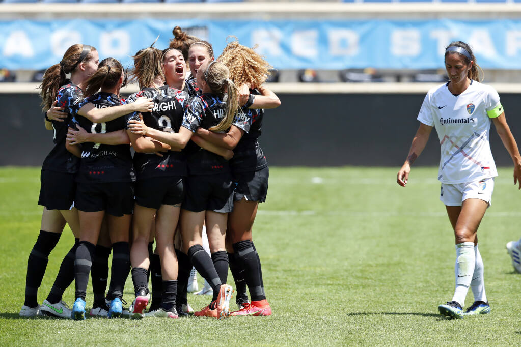 Chicago Red Stars players celebrate after scoring a goal against North Carolina Courage during the first half of a NWSL soccer match, Saturday, June 5, 2021, in Bridgeview, Ill. (AP Photo/Shafkat Anowar)