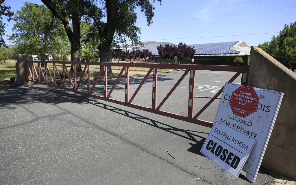 The main gate in to Clos du Bois is locked, Saturday, May 8, 2021, in Geyserville, after the company laid off nearly all of their 37 employees. (Kent Porter / The Press Democrat)