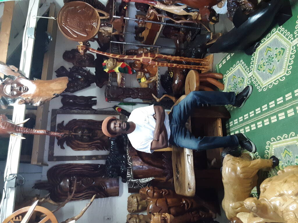 Originally from Jamaica, Vincent S. Malcom of Santa Rosa, shown in his studio, specializes in black walnut and other wood carvings. (Veronica Cruz)