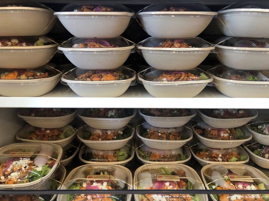 This shows the various compostable salad containers Lunchette restaurant in Petaluma uses. (Naomi Crawford Photo)