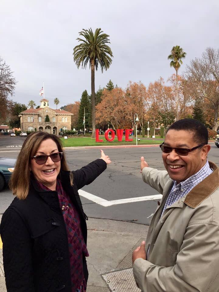 Connie and Maurice Parker salute the 'Love' sculpture installed on the Sonoma Plaza in 2018.