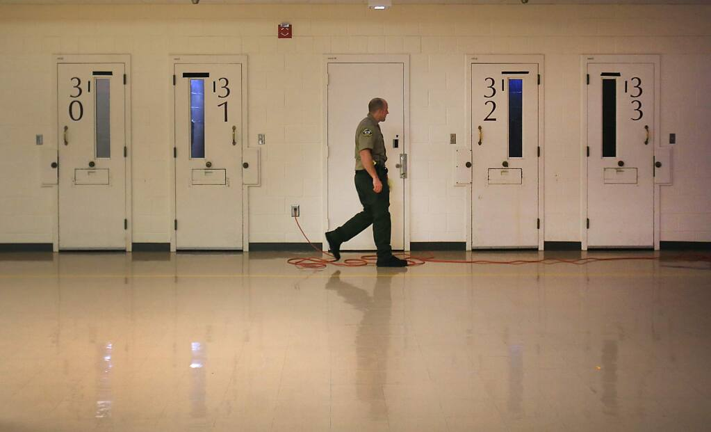 Kent Porter / The Press DemocratMAKING THE ROUNDS: A Sonoma County sheriff corrections officer checks jail cells in the mental health wing at the Sonoma County Main Adult Detention Facility in Santa Rosa in November. In 2016, the Sonoma County Jail held an average of 429 inmates daily with mental illness, ranging from mild depression to severe schizophrenia, up from 228 in 2008.