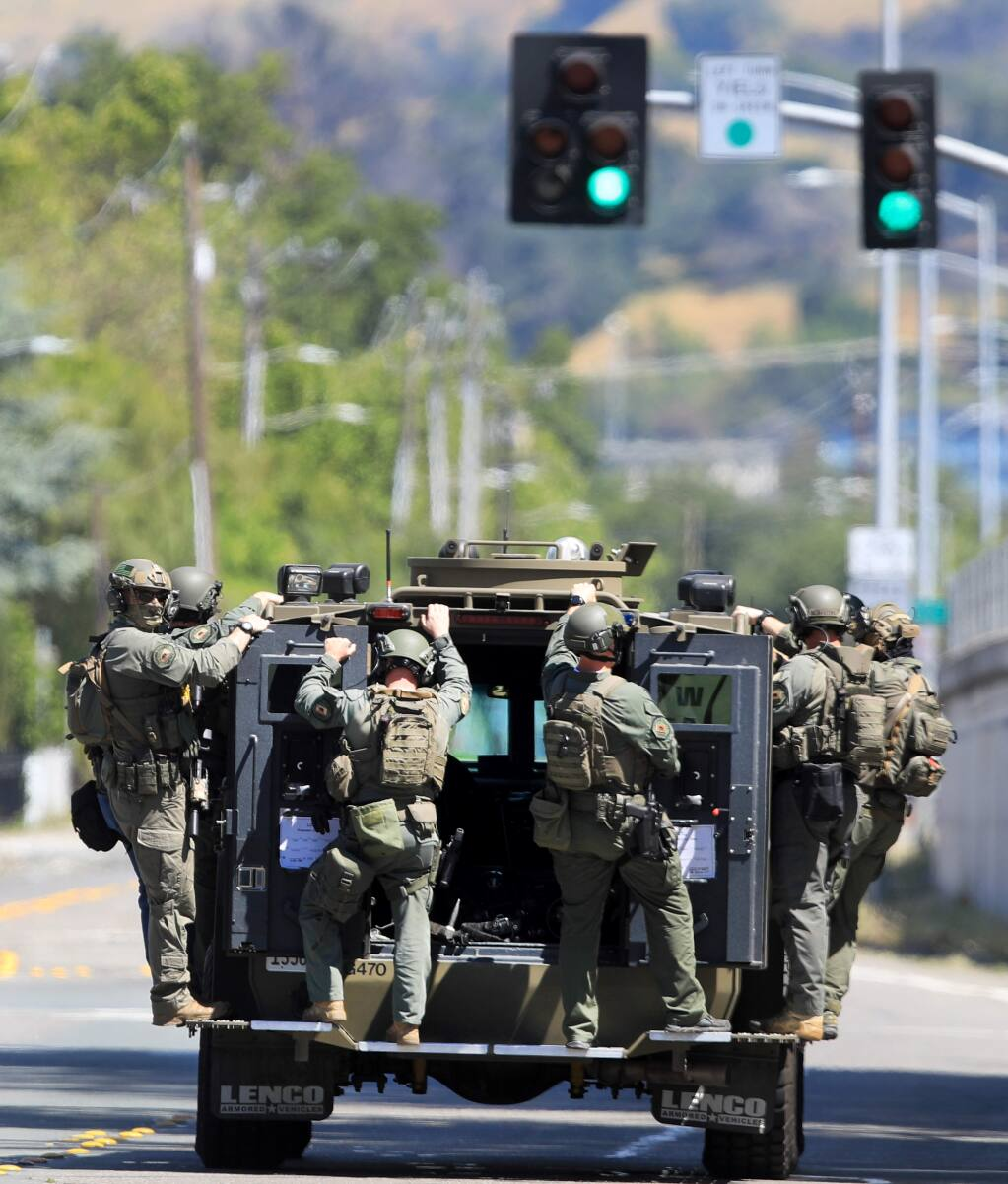 After searching a house on Cleveland Ave., Friday, May 15, 2020 in Santa Rosa, deputies with the Sonoma County Sheriff's Department leave the scene. The search was related to a gang related shooting Thursday night at Andy's Unity Park on Mooreland Ave. (Kent Porter / The Press Democrat) 2020