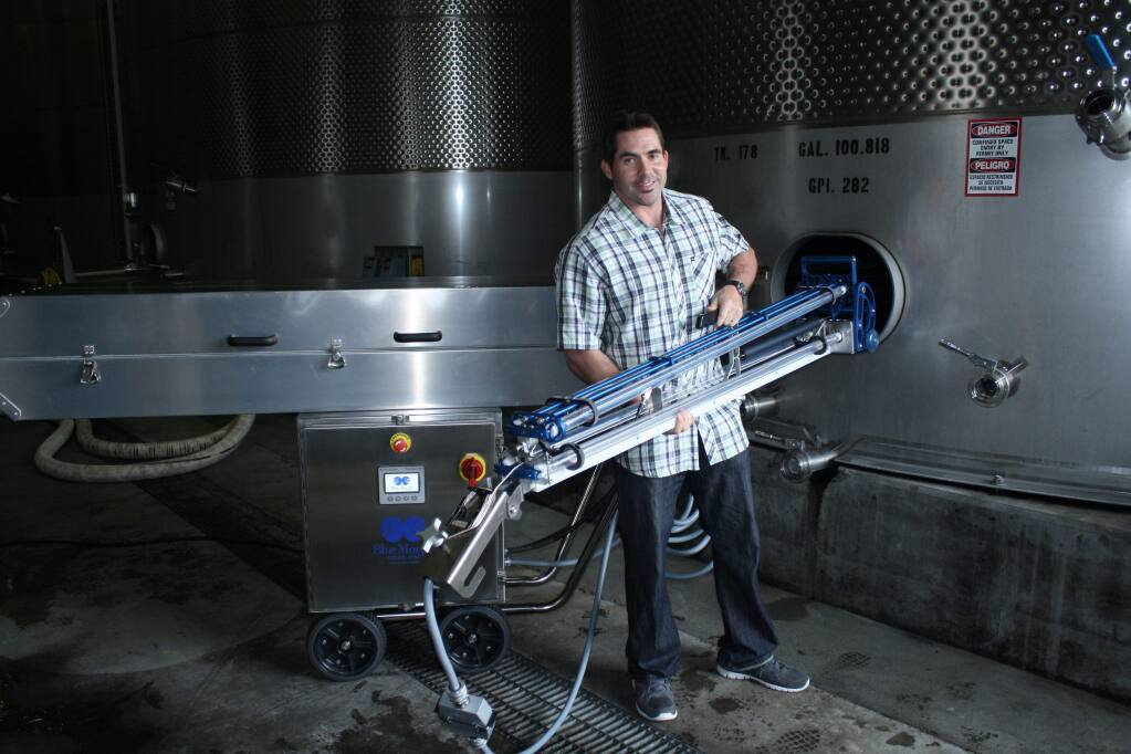 Alex Ferran, CEO and co-founder of BlueMorph, demonstrates his company's new ultraviolet light sanitation system for 100,000-gallon wine storage tanks at Jackson Family Wines in Santa Rosa on Sept. 16, 2015. This is said to be the first deployment of this technology in the wine industry. It's made by Tom Beard Company of Healdsburg. (GARY QUACKENBUSH / FOR NORTH BAY BUSINESS JOURNAL)