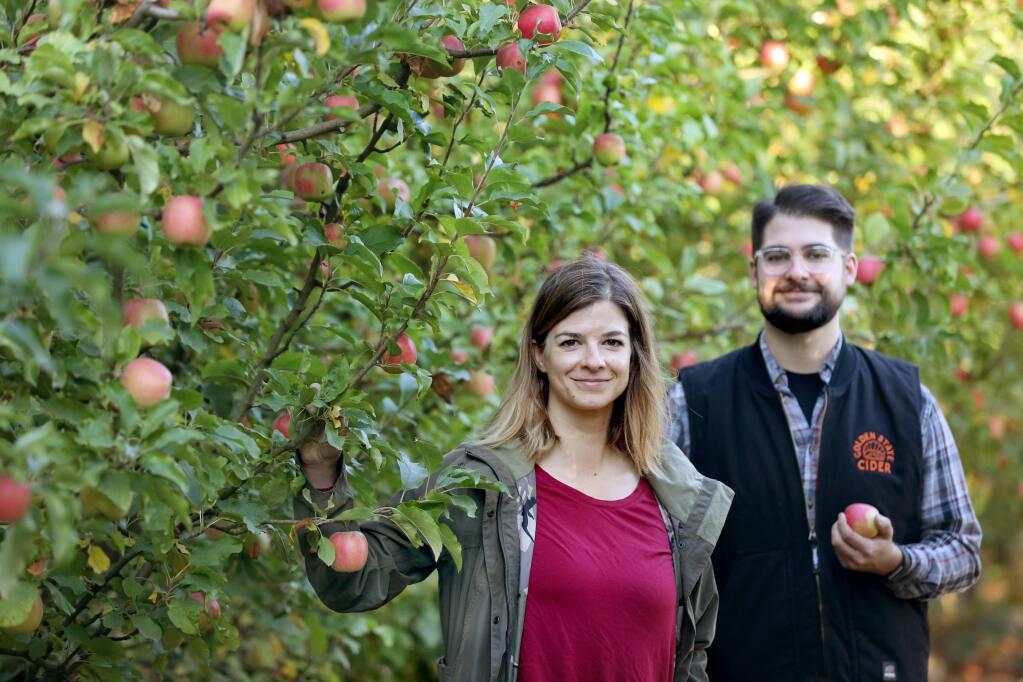 Jolie Devoto, Co-Founder of Golden State Cider, and Tim Godfrey, Head Cidermaker, stand in orchard at Devoto Orchards in Sebastopol on Wednesday, October 23, 2019. (BETH SCHLANKER/ The Press Democrat)