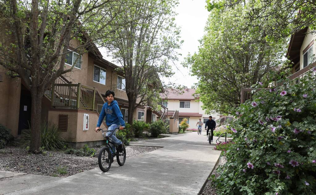 Carlos Soriano, 14, rides his bike with his friends through the Sauvignon Village student housing area at Sonoma State University, in Rohnert Park on Wednesday, April 8, 2020. SSU will provide at least 580 patient beds to help Sonoma County hospitals handle a projected surge of coronavirus cases in the weeks ahead.(Christopher Chung/ The Press Democrat)
