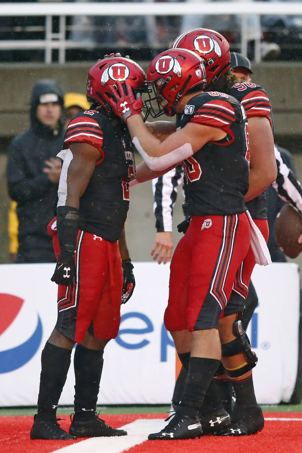 Utah running back Zack Moss, left, celebrates with teammates after his 1-yard touchdown run during the first half against Arizona State on Saturday, Oct. 19, 2019, in Salt Lake City. (AP Photo/Rick Bowmer)