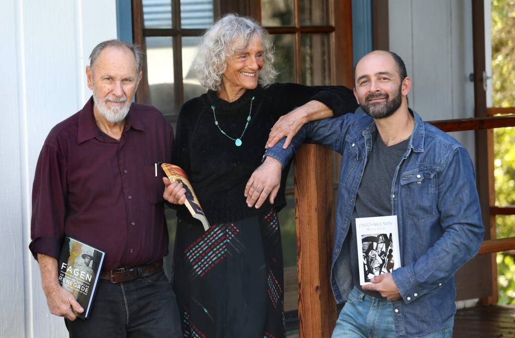 Local authors Michael Morey, left, his wife Barbara Baer, and her son Michael Levitin at their home in Forestville, California on Sunday, February 10, 2019 . (BETH SCHLANKER/The Press Democrat)