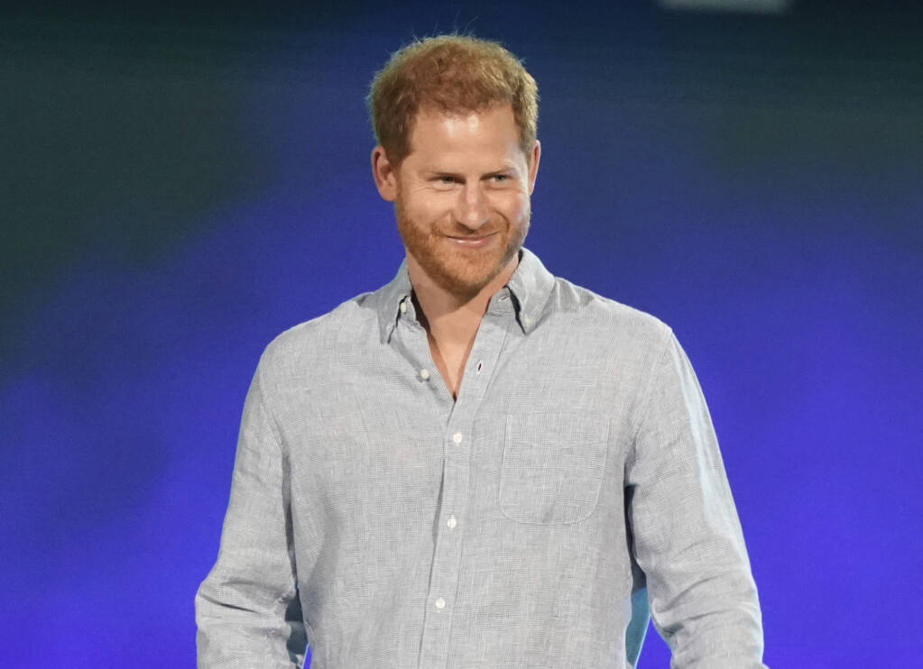 """FILE - In this May 2, 2021, file photo, Prince Harry, Duke of Sussex, speaks at """"Vax Live: The Concert to Reunite the World"""" in Inglewood, Calif. Prince Harry took a break from paternity leave to """"spread the news"""" about his Invictus Games. The Duke of Sussex announced in an Instagram post Wednesday, June 9, 2021, that the Invictus Games will take place in Düsseldorf, Germany, in 2023. (Photo by Jordan Strauss/Invision/AP, File)"""