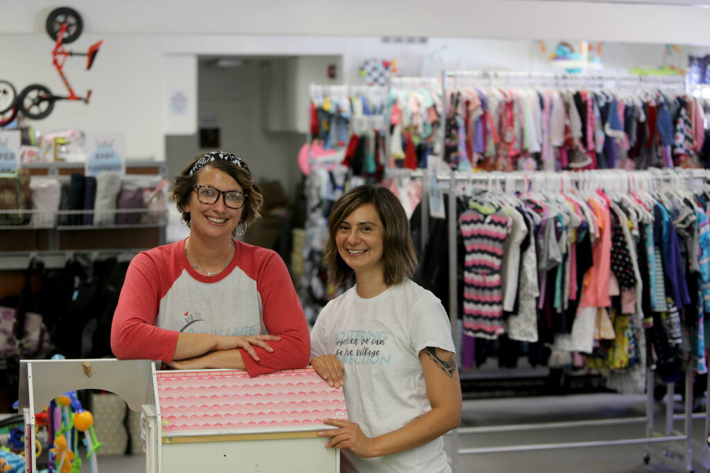 Co-founders Amanda Kitchens, left, and Dominique Soileau at Our Village Closet in Santa Rosa on Wednesday, July 21, 2021. (Beth Schlanker/The Press Democrat)