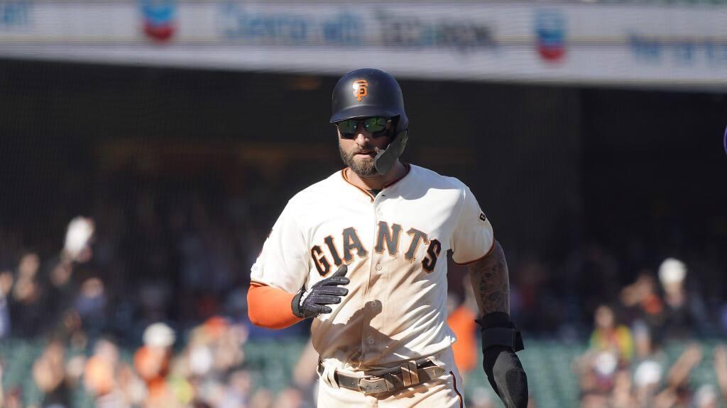 San Francisco Giants' Kevin Pillar (1) scores a run against the Colorado Rockies during a baseball game Thursday, Sept. 26, 2019, in San Francisco. (AP Photo/Tony Avelar)