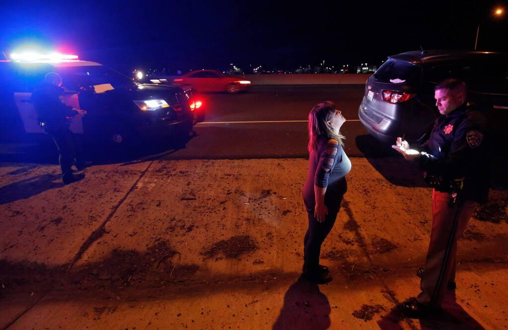California Highway Patrol officer Josh Miller administers a field sobriety test.. (ALVIN JORNADA / The Press Democrat)