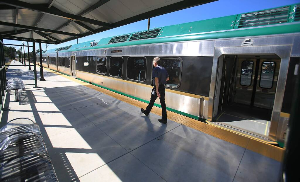 Matt Stevens, SMART's community education and outreach employee, uses the new Airport Blvd. station to take photos of a SMART railcar, Wednesday June 29, 2016 in Santa Rosa. (Kent Porter / Press Democrat) 2016