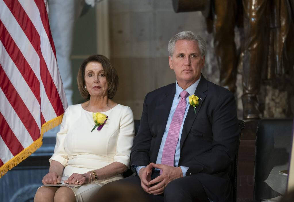 Speaker of the House Nancy Pelosi, D-Calif., and House Republican Leader Kevin McCarthy, D-Calif., right, sit together at an event to commemorate the 100th anniversary of House passage of the 19th Amendment, which gave women the right to vote, at the Capitol in Washington, Tuesday, May 21, 2019. More Democrats in Pelosi's caucus are calling for impeachment proceedings against President Donald Trump after his latest defiance of Congress by blocking his former White House lawyer from testifying on Tuesday. (AP Photo/J. Scott Applewhite)