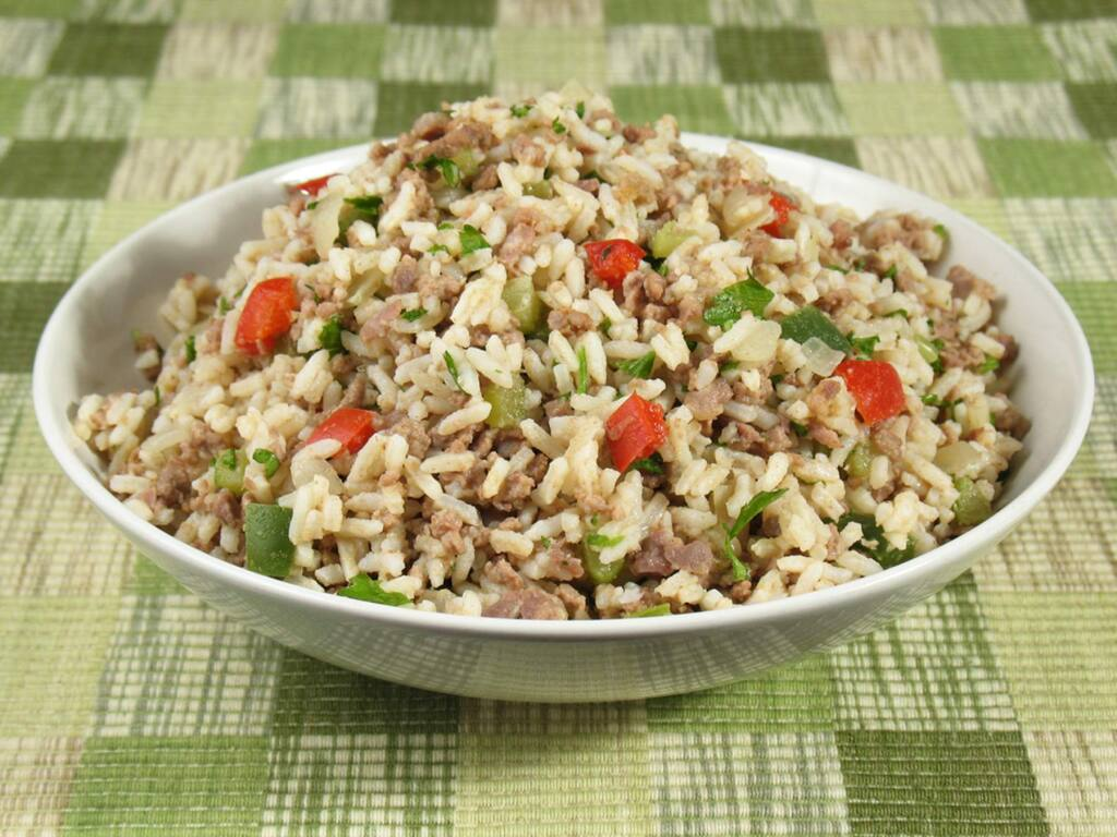 Dirty rice, a classic Cajun dish, is delicious with roasted or fried chicken, grilled sausages, pork chops and such. It also is excellent topped with boiled crawfish or with Gulf shrimp.