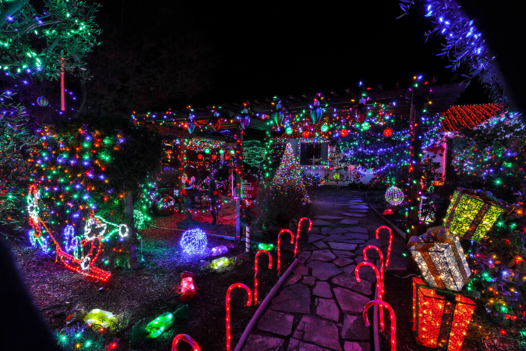 Barry and Arlene Weeks holiday lights on display at 6026 Elsa Avenue  in Rohnert Park, Sunday,  Dec. 6, 2020. (Will Bucquoy/For the Press Democrat)