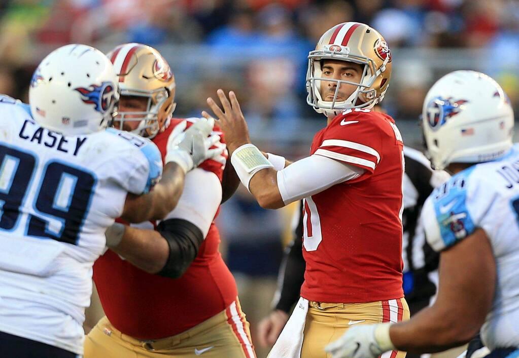Jimmy Garoppolo looks to pass against the Titans, Sunday Dec. 17, 2017 in Santa Clara. (Kent Porter / The Press Democrat)