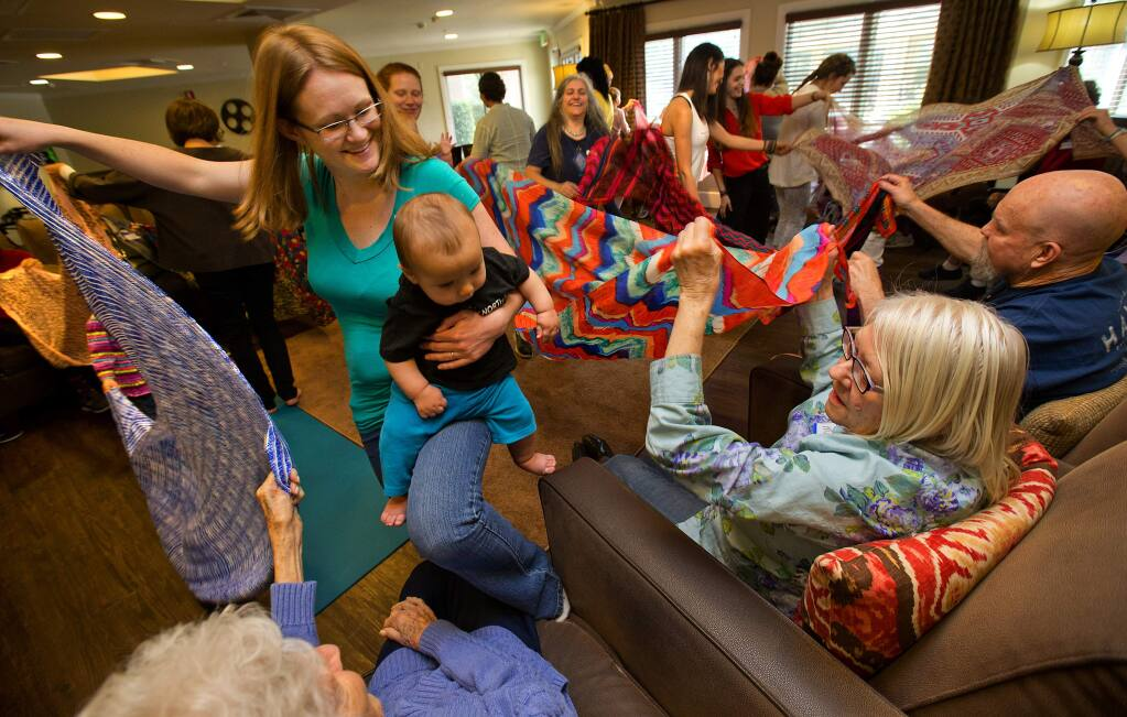 Kayla Flores Tindall dances and sings with her son Amani, 6 months while Betty Wooley, Marilyn Stewart and Ron Casera help on the other end of scarfs during a Music Together class at the Sunrise Villa in Santa Rosa on Friday, March 9, 2018. (photo by John Burgess/The Press Democrat)