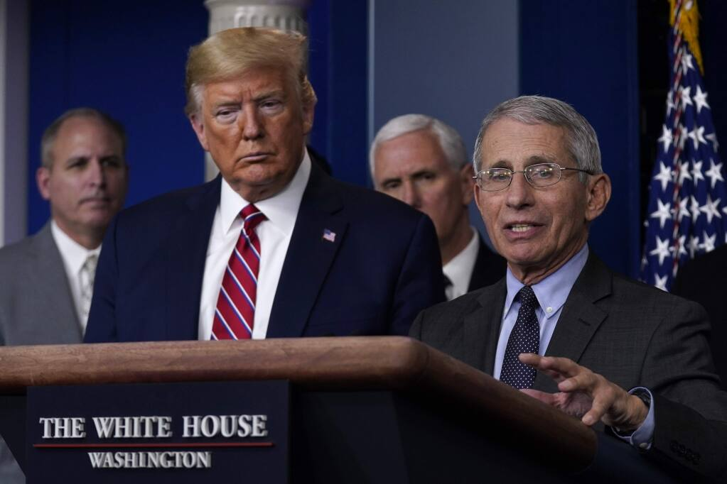 President Donald Trump listens as Director of the National Institute of Allergy and Infectious Diseases Dr. Anthony Fauci speaks during a coronavirus task force briefing at the White House, Friday, March 20, 2020, in Washington. (AP Photo/Evan Vucci)