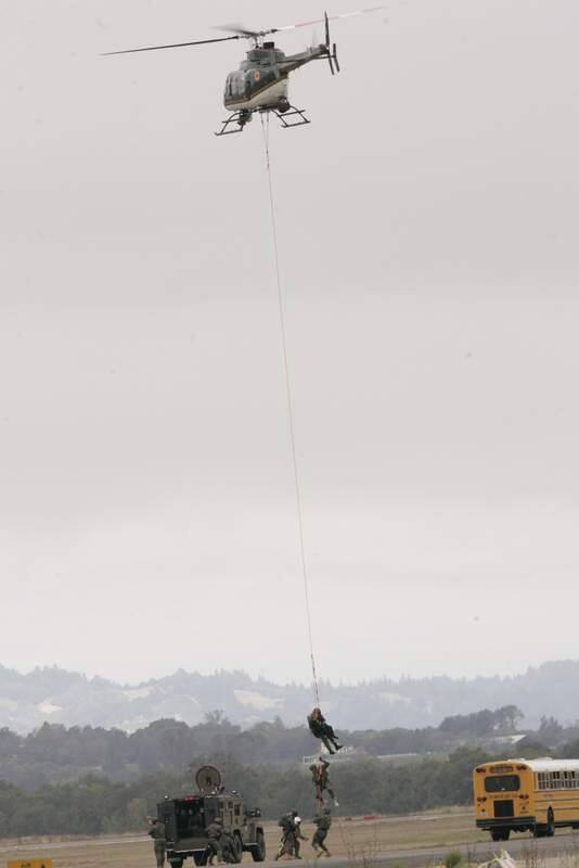 Sheriff's helicopter Henry 1flies long line hostage rescue demonstration Saturday Sept. 20th, 204 at the Wings Over Wine Country Air Show at the Charles M. Schulz Sonoma County Airport. (Chad Surmick / The Press Democrat)